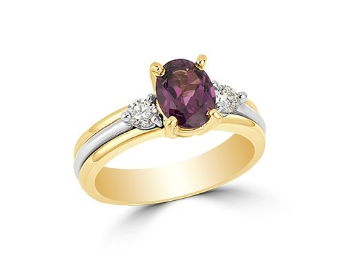 Violetish-red precious gemstone set in two-tone gold