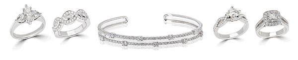 One diamond bangle in between four diamond rings